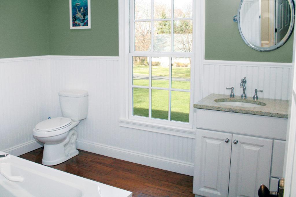 Kleer Lumber cellular PVC wainscoting in bathroom